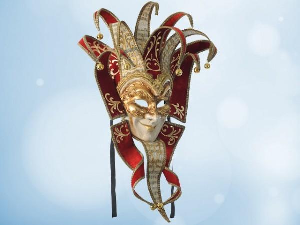 Máscara del Guasón en terciopelo rojo